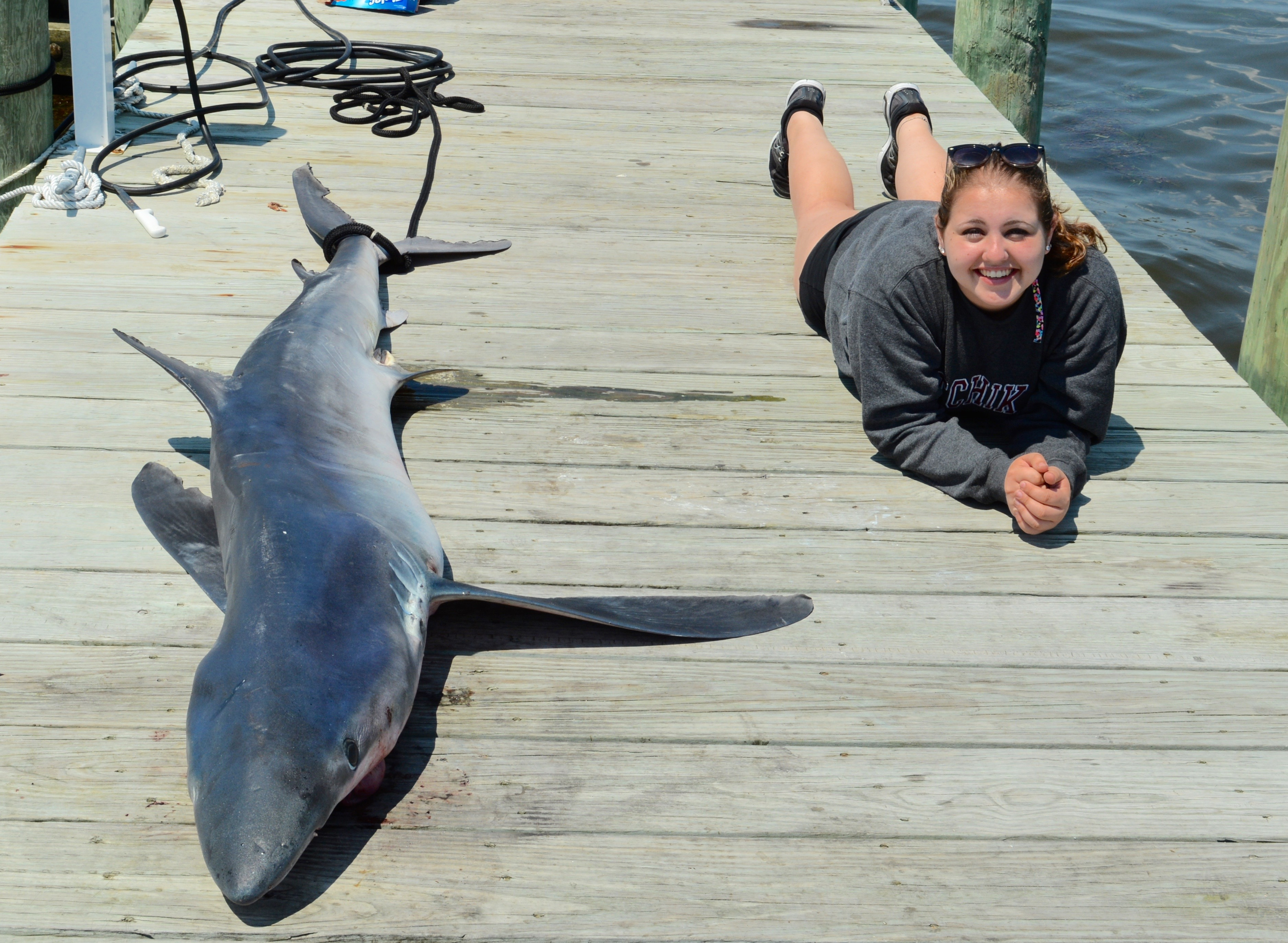 "5'5"" Allie Henner with 8'9"" Mako Shark on Dunewood's ""L-Dock"""